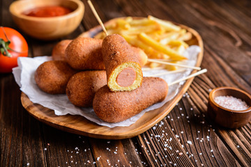 Homemade corn dogs with fries, ketchup and mustard