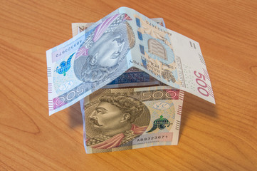 500 PLN Polish zloty as house on wooden background.