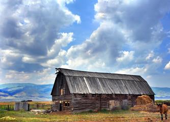 Log Barn and Landscape Scene