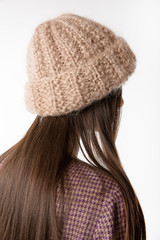knitted cap on the model on a white background