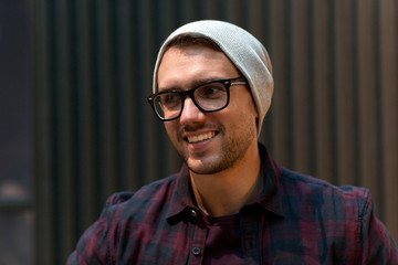 happy smiling man in eyeglasses and hipster hat