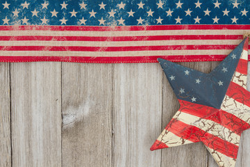 USA patriotic old flag and a star on a weathered wood background