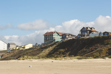 Residential homes in coastal town with beach-front property