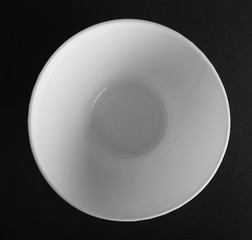Deep round porcelain dish. White bowl top view