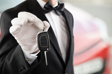 Valet Boy Holding A Car Key