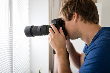 Male Holding Camera Photographing