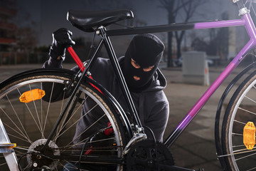 Thief Trying To Break The Bicycle Lock