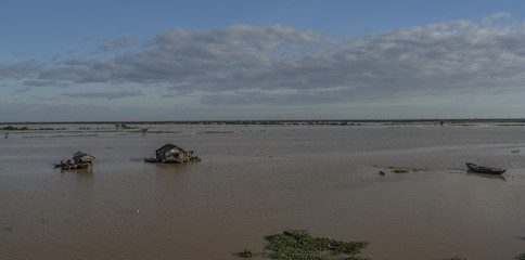 Boats and cottage near Tonle Sap lake
