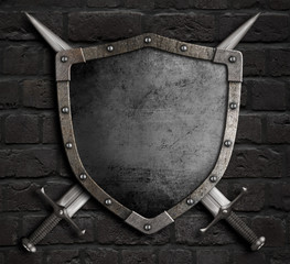 Wall Mural - medieval shield with crossed swords on brick wall 3d illustration