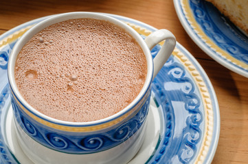 Traditional mexican hot chocolate cup with cinnamon
