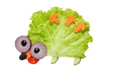 Funny hedgehog made of vegetables on white background