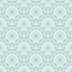 Rising sun seamless pattern. Stylish textile print with lacy design. Mint ethnic fabric background.
