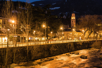 Night view of central part of Merano, little cute town at Dolomite Alps, Bolzano province, Trentino-Alto-Adoge region, Italy.