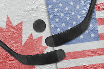 Canadian and American flags, and two hockey sticks hockey