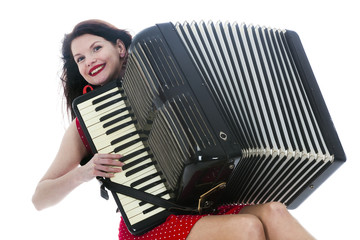 pretty brunette woman plays the accordion in studio with white background