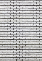 vertical part of light colored brick wall