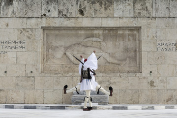 Greek traditional soldiers  front of the tomb of the Unknown Soldier