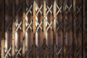 light and shade on old rusty metal folding door