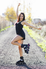 Portrait of beautiful happy woman on the roller-skate in the outdoor. Woman wiht rollerblades.
