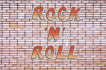 Brick wall with the inscription rock'n'roll for texture background