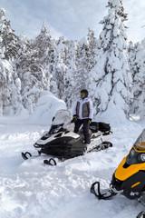 Woman on snowmobile