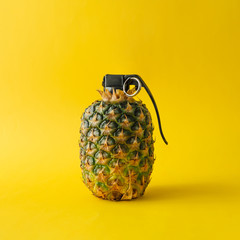 Pineapple bomb on bright yellow background. Minimal fruit concept.