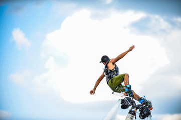 Acrylic Prints Water Motor sports man on flyboard.