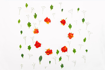 Creative flowers composition. Frame made of roses and leaves. Copy space, flatlay, top view, square. Concept of spring