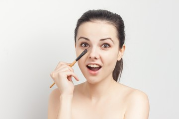 happy woman with makeup brush