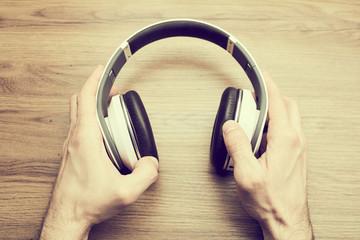 headphones in the hands