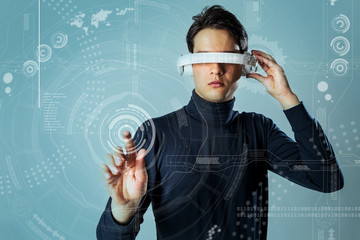 young man who points futuristic user interface, head mount display, heads up display, smart glasses, Internet of Things, abstract concept