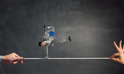 Young businessman breakdancer. Mixed media . Mixed media