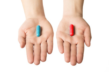 Man hands giving two big pills. Blue and red. Make your selection. Health or ill. Choose your side