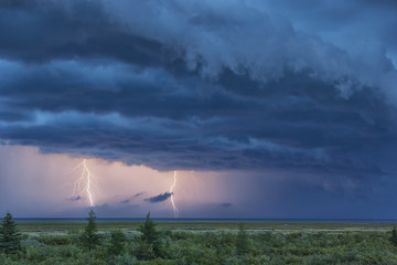 Double lightning strike during a thunderstorm over Hudson bay; Manitoba, Canada