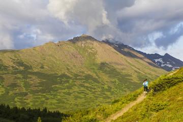Trail runner on Flattop Mountain Trail, Chugach State Park, Glenn Alps; Anchorage, Alaska, United States of America