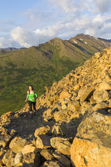 Trail runner on Flattop Mountain Trail, Chugach State Park, Glenn Alps; Anchorage, Alaska, United States of America