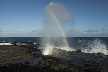 Spouting Horn near Poipu, a blow hole, a lava tube that spouts when waves enter the tube; Lawai, Kauai, Hawaii, United States of America