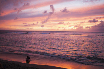 Sunset over water, Kee Beach at Haena Beach State Park; Haena, Kauai, Hawaii, United States of America