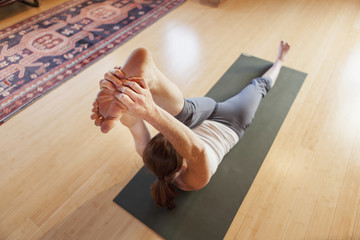 Woman exercising yoga in the gym