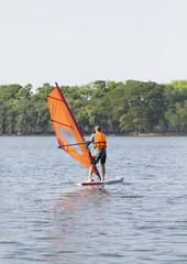 Winsurfing on calm lake