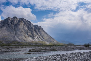 Dramatic skies along the Marsh Fork of the Canning river in the Arctic National Wildlife Refuge, summer, Alaska