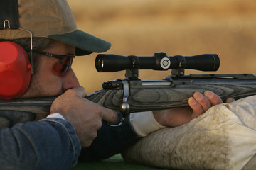 Man Shooting Rifle On Shooting Range