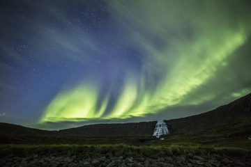 Northern lights over Dynjandi in the Westfjord region; Iceland