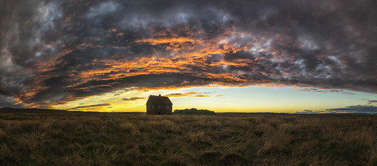 Abandoned house in rural Iceland with a beautiful sunset in the sky; Iceland
