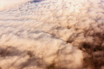 Aerial view of clouds obscuring the Kigluaik Mountains, North of Nome, Seward Peninsula; Alaska, United States of America