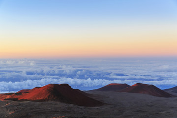 Cinder cones and caldera from ancient lava eruptions atop 4200 meter Mauna Kea, tallest mountain in Hawaii, at sunset; Island of Hawaii, Hawaii, United States of America