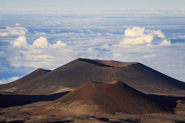Cinder cones and calderas from ancient lava eruptions atop 4200 meter Mauna Kea, tallest mountain in Hawaii; Island of Hawaii, Hawaii, United States of America