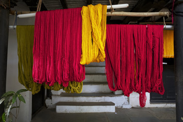 Colourful recently dyed thread hanging out to dry at weavers