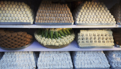 Display of Indian sweets in a sweetshop in the bazaar