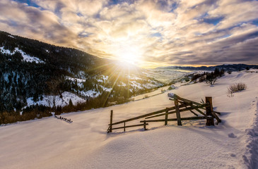 winter sunrise in mountainous rural area